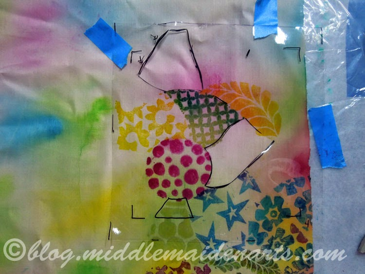 clear stencil on top of fabric