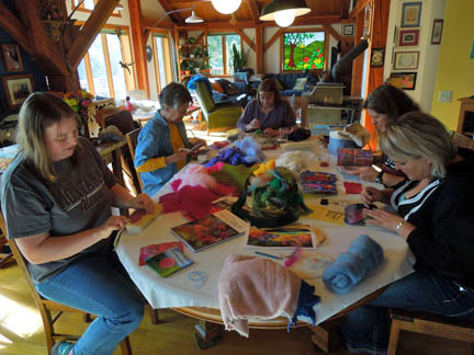 5 ladies sitting at the table needle felting in details